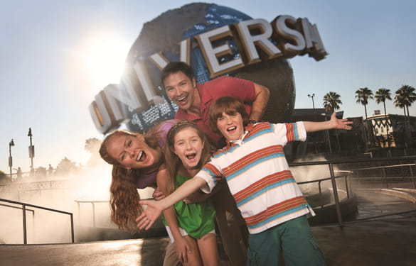 Mom, Dad and two kids standing in front of Universal Studios Globe in themepark