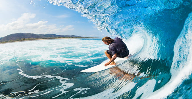 Young man surfing in Hawaii