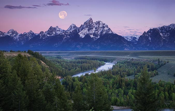 Moon rising over Rocky Mountains