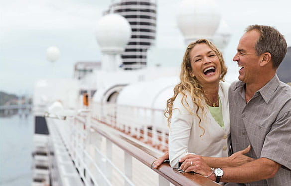 Older Couple laughing on a Luxury Cruise Ship