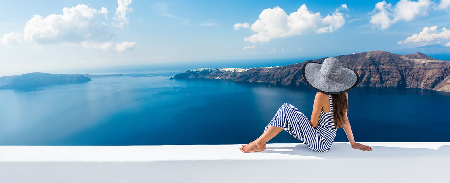 Woman looking at view on famous travel destination