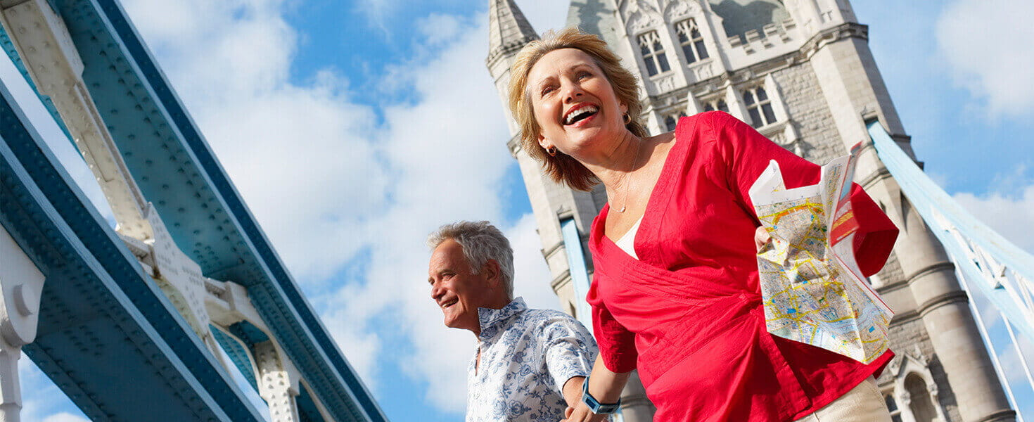 Happy senior couple traveling in London England