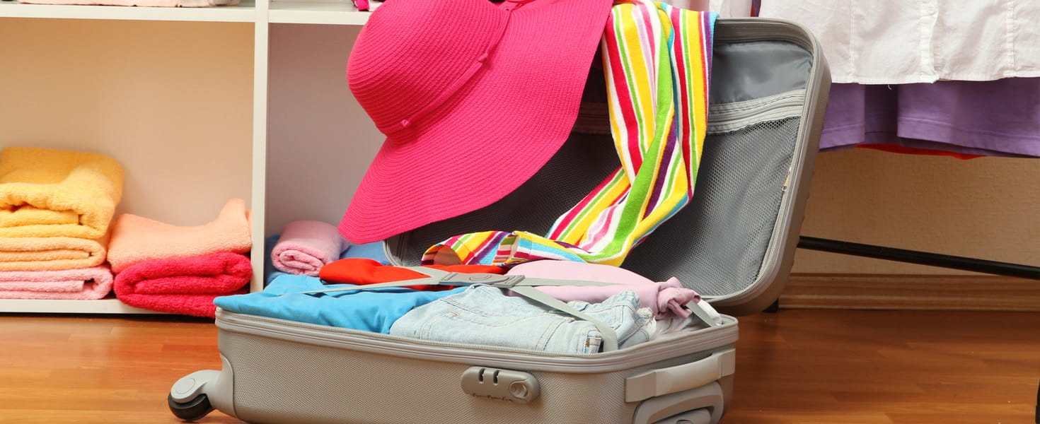 Carry-On Suitcase, open and being packed with clothes