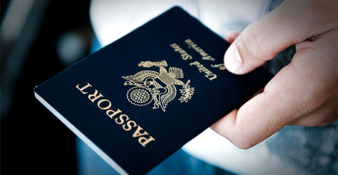 Persons hand holding a passport