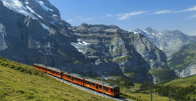 Aerial View of Train in the Snowy Peaks Alps