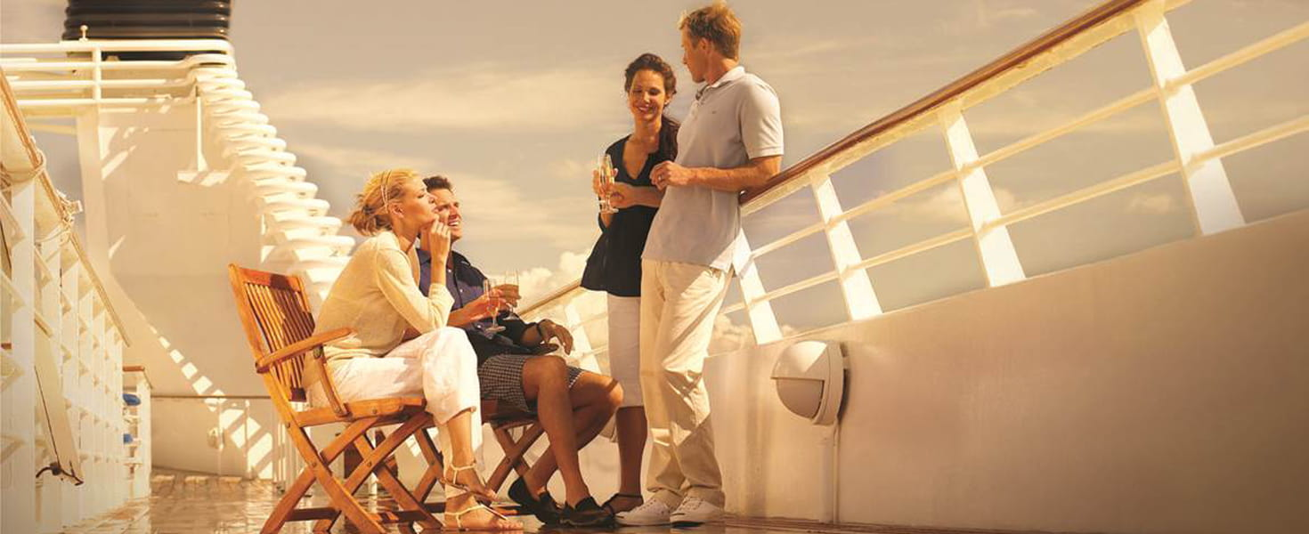 Two couples having drinks on the deck of a Seabourn cruise ship
