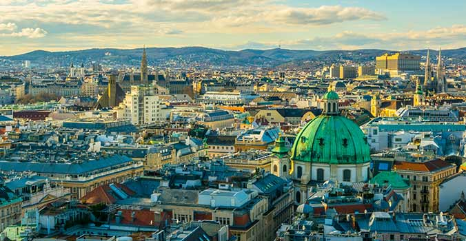 Aerial view of Vienna with tower of the town hall building, votivkirche and peterskirche churches from the stephansdom cathedral
