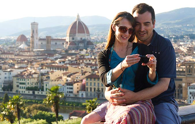Couple taking photo together in Italy