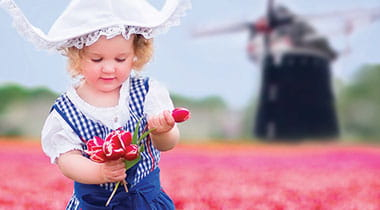 Young holland girl holding tulips