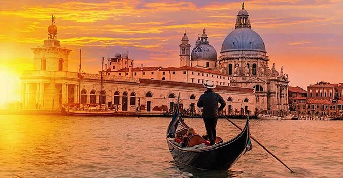 Sunset and gondola in Venice