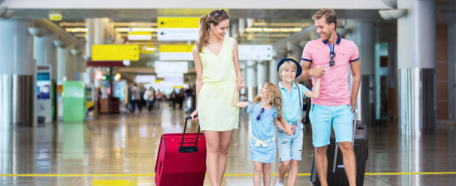 Family with children with a suitcase at the airport