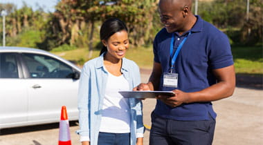 Driver instructor talking to student learner before taking driving test