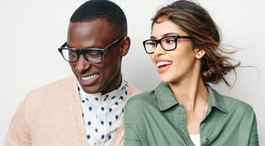 Couple wearing smiling wearing eyeglasses