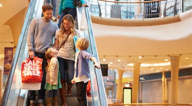 Family on a Escalator in the Shopping Mall