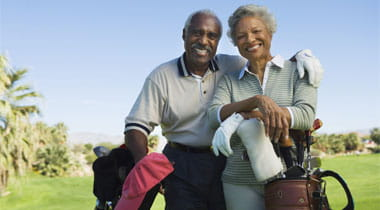 Senior couple portarit smiliing on the golf course