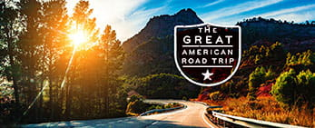 AAA Road Trip Resources menu image of winding road at sunset