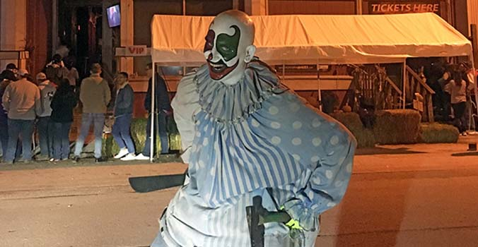 Kansas City Mo Killer clown outside Macabre Cinema in West Bottoms